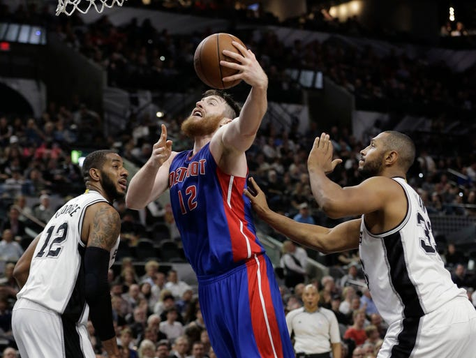 Detroit Pistons center Aron Baynes (12) drives to the