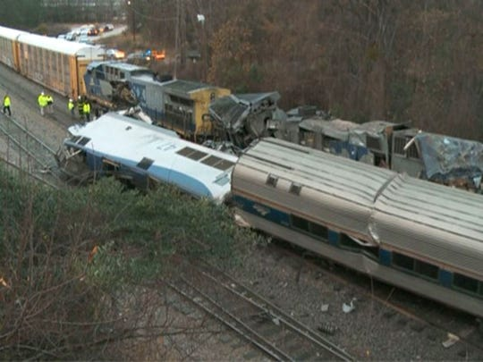 In this image from video, train cars are smashed and