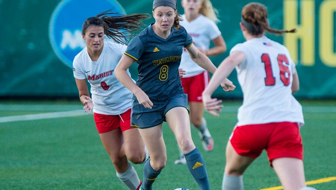 The University of Vermont's Aly Spencer, center, weaves between Marist College's Amanda Garrity, left, and Tori Flaherty in Burlington on Tuesday, September 12, 2017.