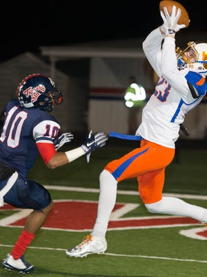 Will Brooks lands a 39 yard reception for a Madison Central touchdown as Donald Twilley defends.
