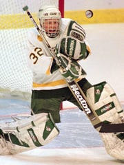 Vermont goaltender Tim Thomas makes a save during the first period of a 1997 NCAA East Regional game at the Worcester Centrum in Worcester, Mass.