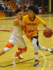 Golden West's Shemar Smith dribbles down court against