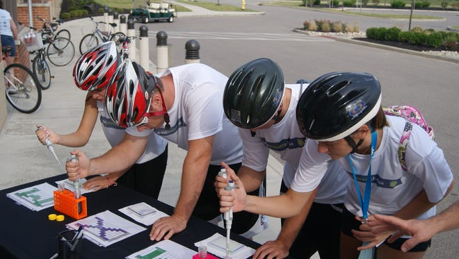 "Participants compete in a challenge during the Great Mason Chase in 2013.  The four-hour competition pits teams of two in a race to become the ""Top Chasers"" of Mason."