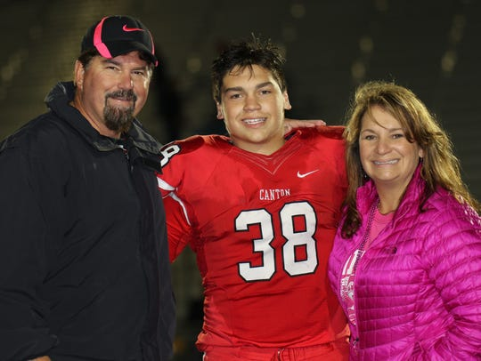 Canton junior Lou Baechler poses with his proud parents,