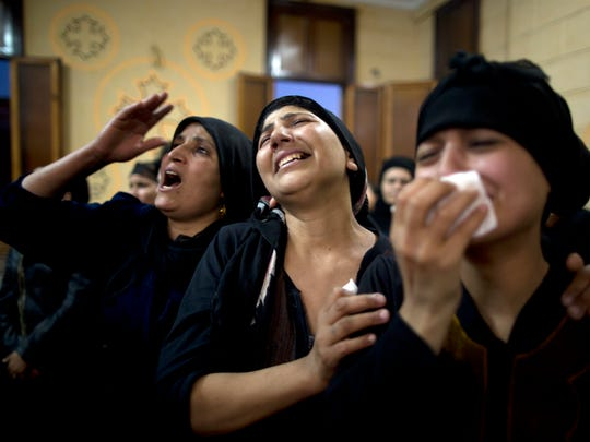 Relatives of killed Coptic Christians grieve during their funeral at Abu Garnous Cathedral in Minya, Egypt, Friday, May 26, 2017. Egyptian officials say dozens of people were killed and wounded in an attack by masked militants on a bus carrying Coptic Christians, including children, south of Cairo.