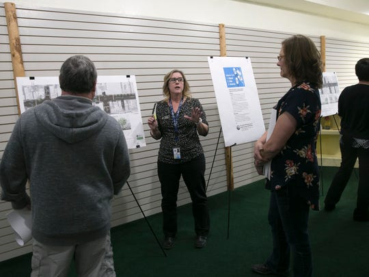 Shana Reeves, director or communications for the city of Farmington, talks with community members Tuesday at the Complete Streets headquarters in Farmington.