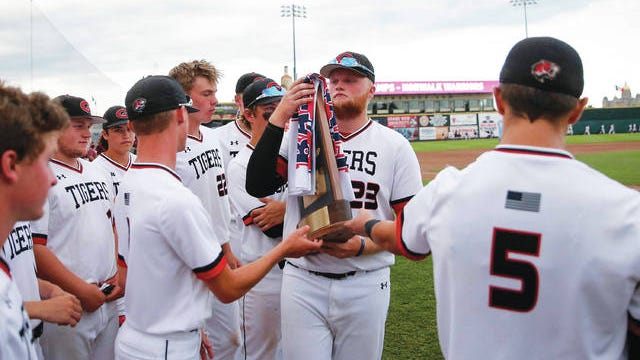 Members of the Gilbert baseball team accept the Class 3A state runner-up trophy after dropping an 8-6 decision to Norwalk on Saturday at Principal Park in Des Moines. Photo by Bryon Houlgrave/Des Moines Register