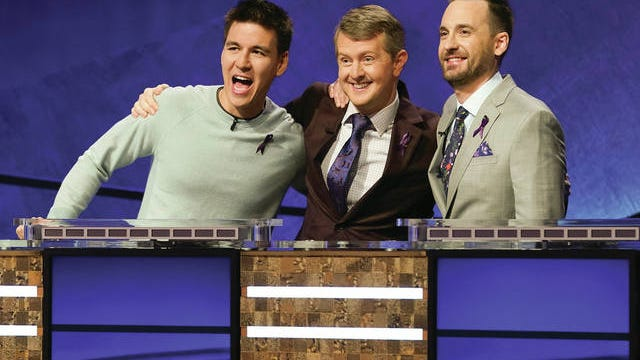 """In this image released by ABC, contestants, from left, James Holzhauer, Ken Jennings and Brad Rutter appear on the set of """"Jeopardy! The Greatest of All Time,"""" in Los Angeles. The all-time top """"Jeopardy!"""" money winners; Rutter, Jennings and Holzhauer, will compete in a rare prime-time edition of the TV quiz show, which will air on consecutive nights beginning Tuesday."""