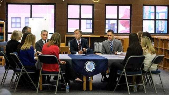 Gov. Bill Haslam, center, Tuesday talks with county teachers, principals and system officials at Cedar Grove Elementary in Smyrna. County Schools Director Don Odom, left of Haslam, and Cedar Grove Principal Mark Gullion, right, listen to the discussion.