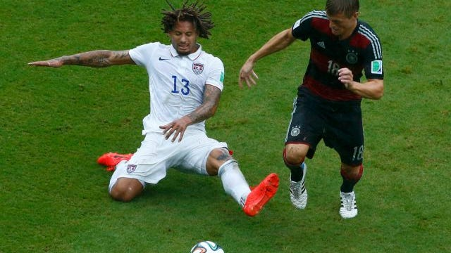 Jermaine Jones of the U.S. (13) fights for the ball with Germany's Toni Kroos during their 2014 World Cup Group G soccer match at the Pernambuco arena in Recife June 26.