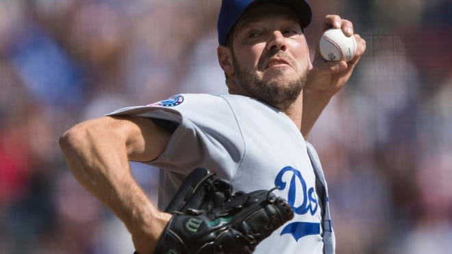 Los Angeles Dodgers starting pitcher Rich Hill throws against a San Francisco Giants batter in the second inning of a baseball game in San Francisco, Sunday, Sept. 30, 2018. (AP Photo/John Hefti)