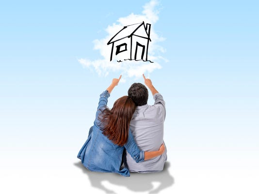 Young couple  imaging and dreaming of new house