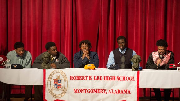 From left, Lee football players Miles Evans, signing with Stillman College, Ta'wonya Carter, invited to play football at Huntingdon College, Adrian King, signing with Tennessee Chattanooga, Joshua Smiley, signing with West Florida and Marquis Howard, signing with Northern Illinois, speak to football players and family on Wednesday February 4, 2015 at Lee High School in Montgomery, Ala.