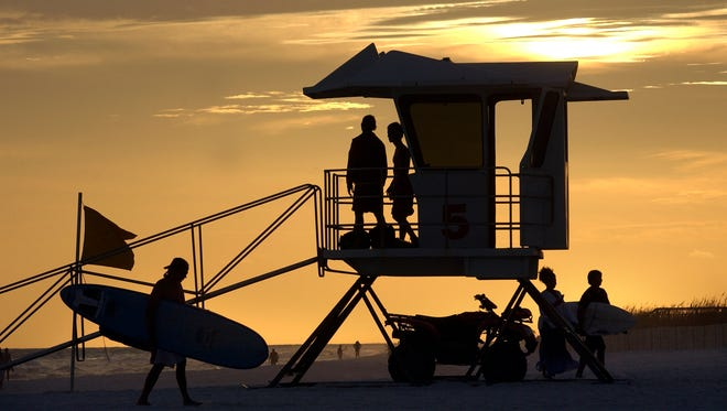 Sunday, he last day of the summer season for Pensacola Beach lifeguards, draws to a close and Pensacola lifeguards Nikolas Sharp and Greg Leenig prepare to pack up lifeguard tower No. 5 for the last time in the 2012 season.
