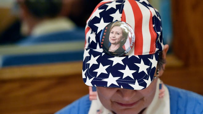 Cheryl Huber of Springettsbury Township wears a Hillary Clinton button on her baseball cap Tuesday, Nov. 8, 2016, at the Democratic Party of York County's election watch party at the Roosevelt Tavern in York, Pa.