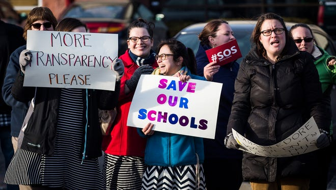 "Hundreds of teachers, students and community members gathered for the ""Save MCS"" rally at the intersection of McGalliard Road and Wheeling Avenue Friday evening."