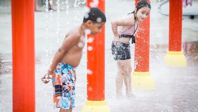 Children play at The Daleville Town Hall Park Splash Pad Saturday afternoon.  The $4.2 million park features two playgrounds, a water feature, public restrooms, a concession stand, a paved walking trail and a performance pavilion. The park has also become a regular stopping site for local food trucks. The Splash Pad, which officially opened on June 3, is open between 10 a.m. and 9 p.m.