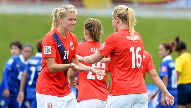 Norway forward Ada Hegerberg (21) and forward Elise Thorsnes (16) react after beating Thailand in a Group B soccer match in the 2015 women's World Cup at Lansdowne Stadium on June 7, 2015.