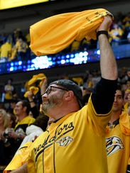 A Predators fan cheers during the third period of Game