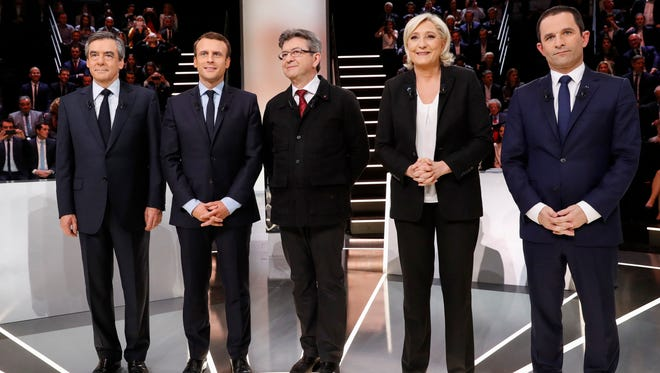From left to right, Conservative presidential candidate Francois Fillon, Independent centrist presidential candidate for the presidential election Emmanuel Macron, Far-left presidential candidate for the presidential election Jean-Luc Melenchon, Far-right presidential candidate for the presidential election Marine Le Pen and Socialist candidate for the presidential election Benoit Hamon pose for a group photo prior to a television debate at French TV station TF1 in Aubervilliers, outside Paris, France, on March 20, 2017.