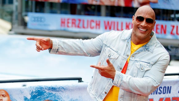 Dwayne Johnson poses during a photocall for 'Baywatch'