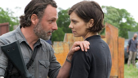 Andrew Lincoln as Rick Grimes, Lauren Cohan as Maggie