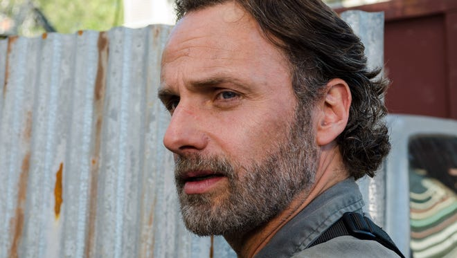 "Andrew Lincoln plays Rick Grimes, a former sheriff's deputy and now leader of a band of people trying to survive a zombie apocalypse, in AMC's hit drama, ""The Walking Dead."""