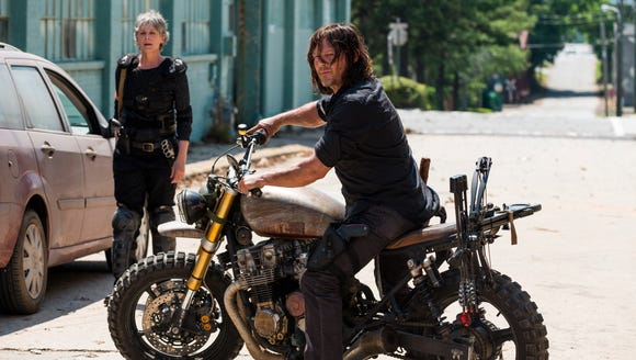 Melissa McBride as Carol Peletier and Norman Reedus