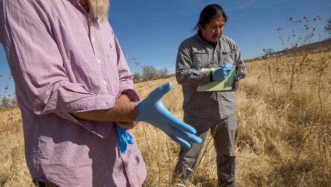 New Mexico State University principal investigator Kevin Lombard and researcher Brandon Francis prepare to collect soil samples on Monday, Feb. 5, 2018 at a farm in Hogback.