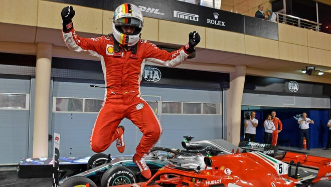 Sebastian Vettel jumps out of his car after winning the Bahrain Grand Prix on Sunday.