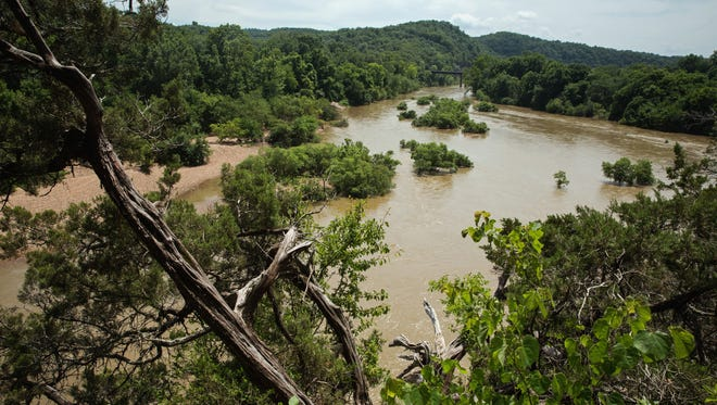 Brown water after a rain is fine for paddling, but you should think twice about swimming.