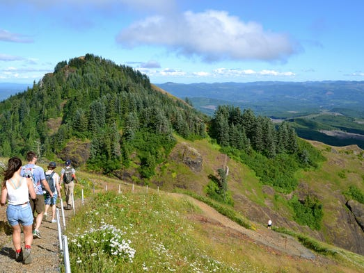 Hikers make their way back down Saddle Mountain near Seaside, Ore.