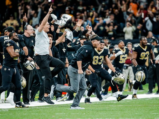 New Orleans Saints head coach Sean Payton and players on the sideline celebrate a game winning kick in overtime against the Washington Redskins of a game at the Mercedes-Benz Superdome.