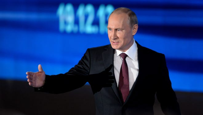 Russia's President Vladimir Putin gestures during his annual press conference in Moscow on Dec. 19, 2013.