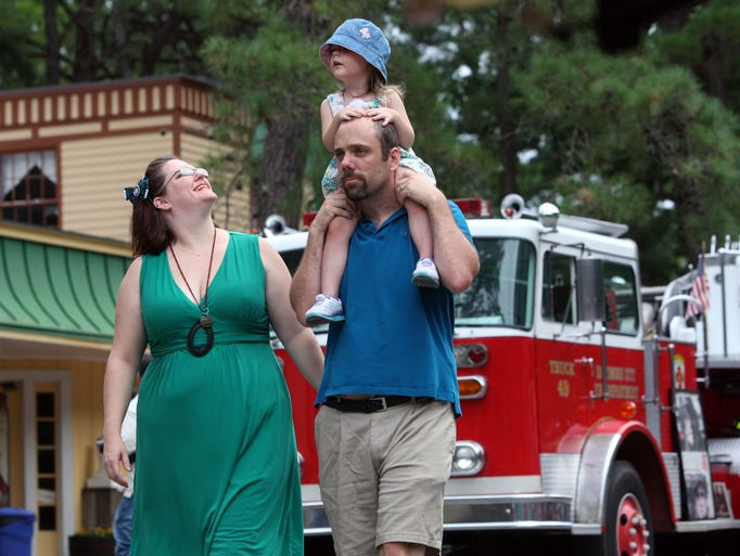 Amber and Paul Bowen of Mizpah, with their two year-old daughter Clarissa Bowen, at the annual Antique Fire Apparatus Show at Wheaton Arts and Cultural Center in Millville, Sunday, Aug. 17, 2014.  Staff Photo/Sean M. Fitzgerald