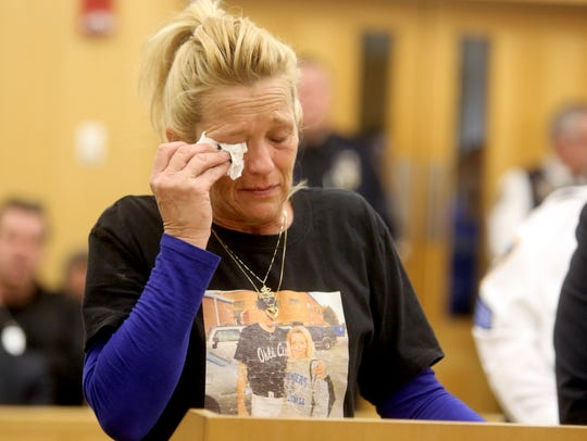 Donna Nolan cries as she talks about her son Michael