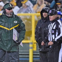 Green Bay Packers head coach Mike McCarthy yells at an official after a play against the Chicago Bears at Lambeau Field.