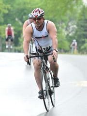 Mark Rasner bikes in June during the Aurora BayCare Green Bay Triathlon.