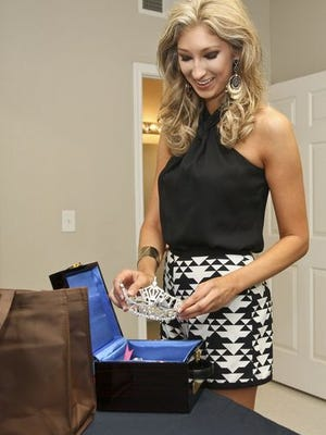 Lauren Ford, Miss University of Louisiana at Monroe, unpacks her crown as she settles in at Bayou Suites at ULM. The 2015 Miss Louisiana Pageant contestants are staying at ULM during pageant week.