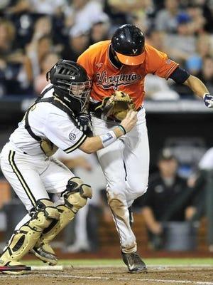 Vanderbilt catcher Jason Delay collides with a Virginia runner.