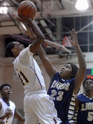 East High's Wendell Lucas puts up a shot over Leadership Academy's Davon Brown earlier this month.