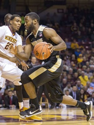 Purdue guard Rapheal Davis (35) drives to the basket past Minnesota Golden Gophers forward Charles Buggs (23) in the first half at Williams Arena.