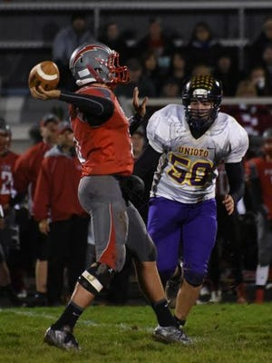 Unioto's Cameron Bryce rushes Piketon quarterback Gabe Birkhimer last season at Piketon High School. Bryce ended last season with nine sacks and 14 tackles for a loss.