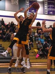 Galena's Moses Wood grabs a rebound against Spanish