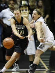 Purdue's Hayden Hamby reaches in to strip the ball from UW-Green Bay's Mehryn Kraker Wednesday, November 19, 2014, at Mackey Arena on the campus of Purdue University.