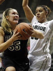 UW-Green Bay's Sam Terry pulls down a rebound in front of Liza Clemons Wednesday, November 19, 2014, at Mackey Arena on the campus of Purdue University.