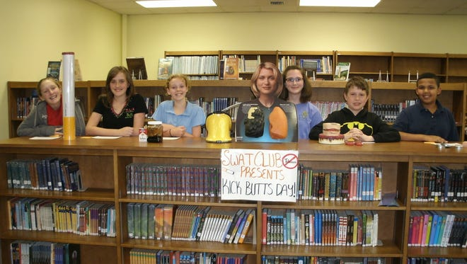 The Murray Middle School SWAT Club creates displays to raise awareness for Kick Butts Day.