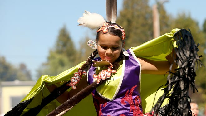 Sydney Abrahamson, 16, of Spokane, takes part in the powwow at Chief Seattle Days in Suquamish on Saturday, August 20, 2016.