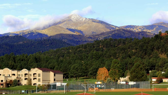A storm moving through Ruidoso that dropped a half inch of rain also left behind the first dusting of snow for the season on Sierra Blanca Peak.