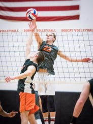 A tip-over at the net by Central York's Carter Luckenbaugh